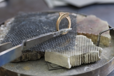 Jewellery making hand crafting a metal ring Stock Photo - 20740125