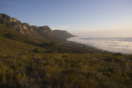 The 12 Apostles of Table Mountain tower above Camps Bay and Bakoven Stock Photo - 20740145