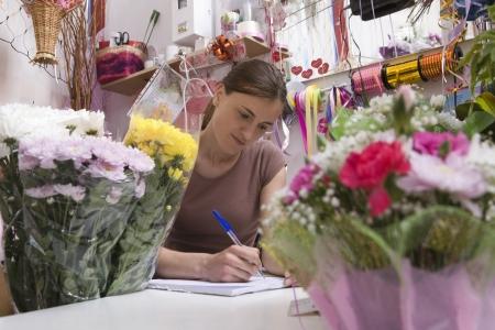 shop keeper: Female florist LANG_EVOIMAGES