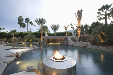 showhome: Palm Springs swimming pool with live flame heater