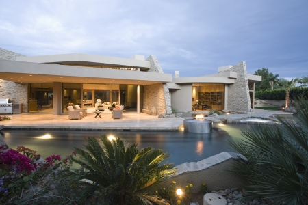 showhome: Palm Springs swimming pool and house exterior at dusk LANG_EVOIMAGES