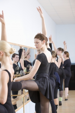 barre: Young women practise ballet at the barre