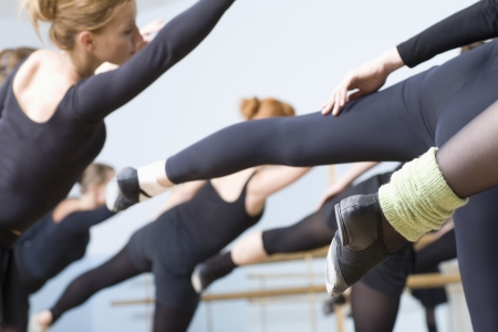 barre: Young women stretch into ballet positions LANG_EVOIMAGES
