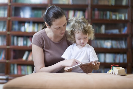 blonde mom: Brunette woman teaches blonde toddler how to read