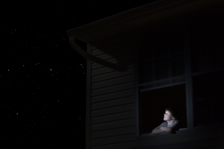Teenage boy looks up at night sky Stock Photo - 20740460
