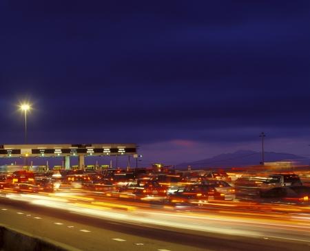 Tail backs of traffic at toll gate in California Stock fotó