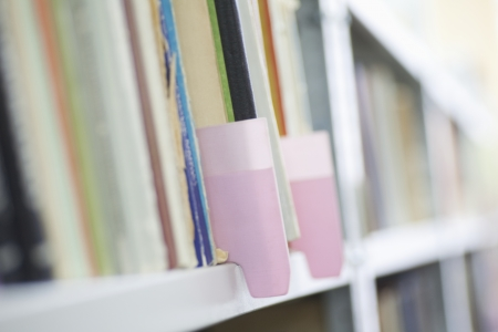 filing system: Colour coded filing system on library shelves