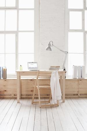 Desk in window area of loft apartment Stock Photo