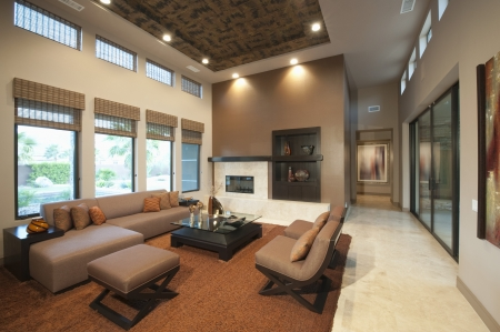 modern living room: Spacious living room with double height ceiling