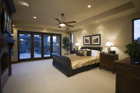 fan ceiling: Dark wood furniture in bedroom with ceiling fan LANG_EVOIMAGES