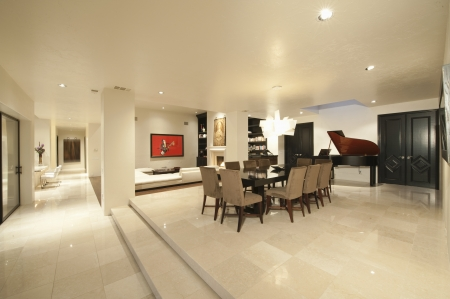 open floor plan: Spacious white living interior with grand piano