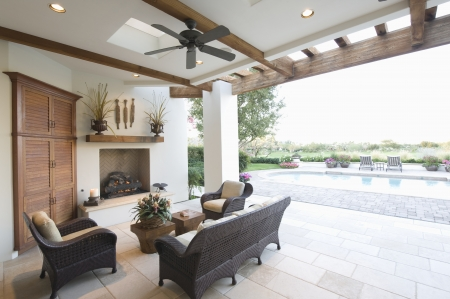 ceiling fan: Beamed poolside outdoor room LANG_EVOIMAGES