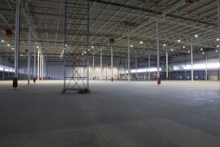Empty warehouse with scaffold Stock Photo