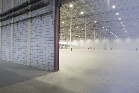 empty warehouse: Access door to brightly lit and empty warehouse LANG_EVOIMAGES