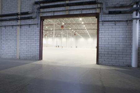 empty warehouse: Access door to empty warehouse