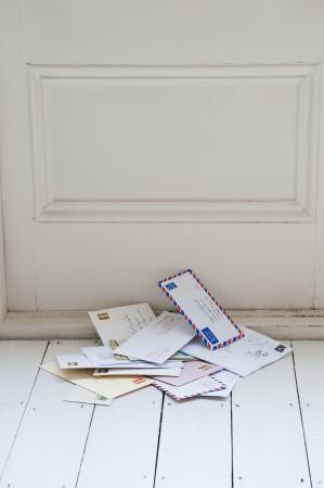 floorboards: Letters on floorboards at front door