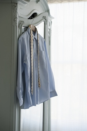 downtime: Shirt and tie hang on wardrobe