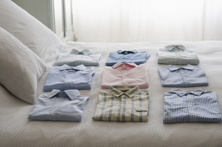 obsessive: Clean shirts ordered on a bed