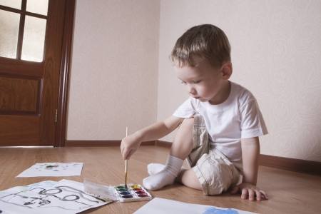 Young boy mixes paints Stock Photo - 20740824