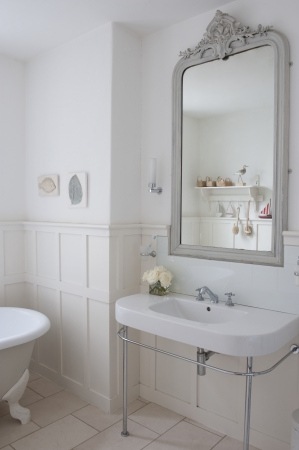 panelled: Grey painted mirror surround in panelled bathroom London