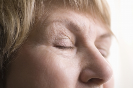 the ageing process: Mature woman skin around eyes