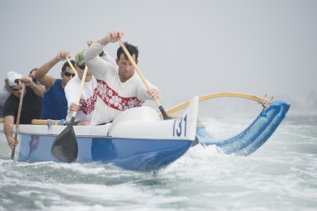outrigger: Outrigger canoeing team on water