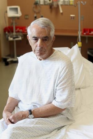 geriatrician: Elderly man sitting on hospital bed