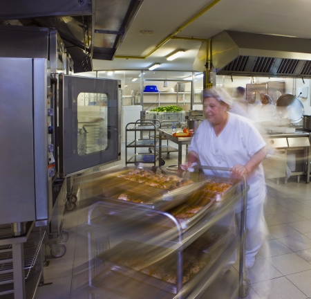 hospital trolley: Kitchen porter pushes a trolley of pastries LANG_EVOIMAGES
