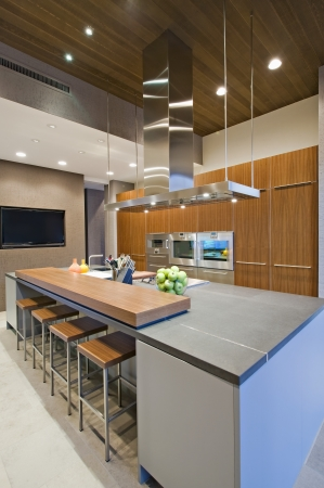 wood panelled: Wood panelled spotlit kitchen in California home
