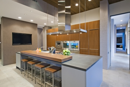 spotlit: Wood panelled spotlit kitchen in California home