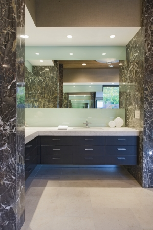 storage units: Storage units and mirror in bathroom of California home