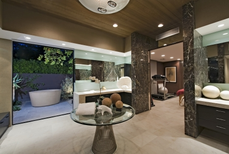glass topped: Bathroom with artwork of freestanding bath in California home