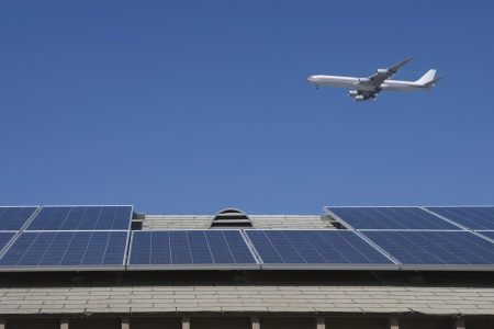 Aeroplane and rooftop with solar array Inglewood Los Angeles California Stock Photo - 20741284