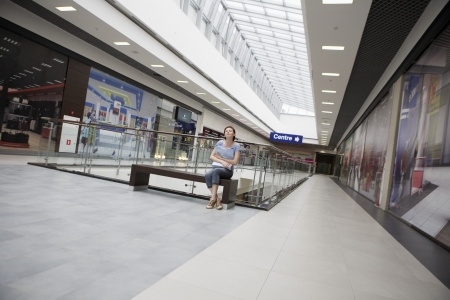 voronezh: Young woman sits in new Voronezh shopping centre