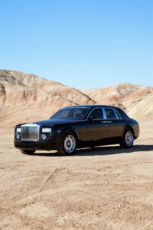 unpaved road: Rolls Royce parked on unpaved road with clear sky