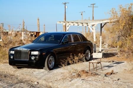 broken chair: Rolls Royce parked next to broken chair in abandoned village