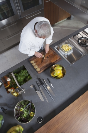 industrial kitchen: Mid- adult chef working  overview