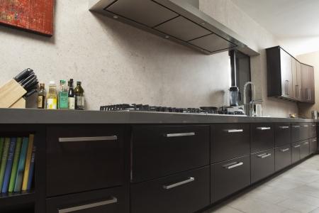 fitted unit: Dark wood kitchen