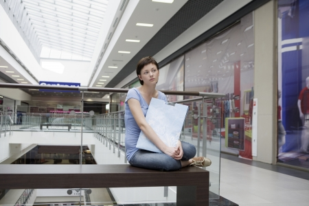 shopping centre: Young woman sits in new Voronezh shopping centre