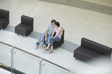 voronezh: Young couple sit together in new shopping mall Voronezh LANG_EVOIMAGES