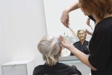 riverside county: Stylist cuts elderly womans hair