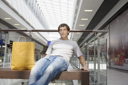 voronezh: Young man sits in new shopping centre Voronezh