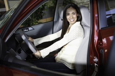 test drive: Portrait of a woman taking a test drive