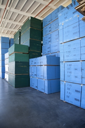 storing: Blue boxes piled up of in warehouse LANG_EVOIMAGES