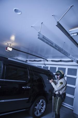 patrolman: Nightwatch patrolman checks luxury car in garage