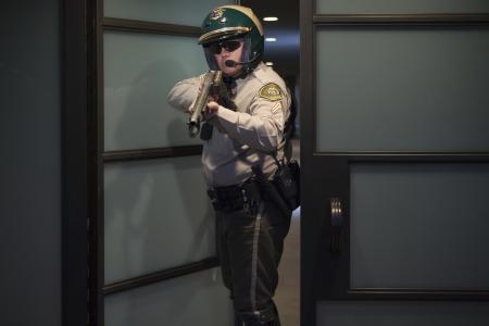 patrolman: Nightwatch patrolman at doorway with rifle