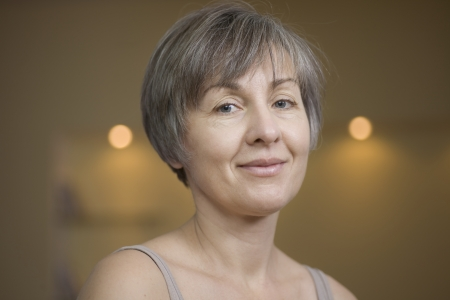 grey hair: Portrait of mature woman with short grey hair