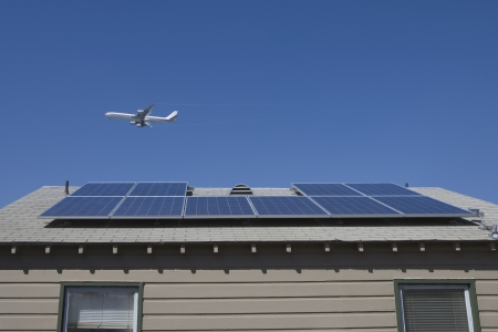 Aeroplane and rooftop with solar array Inglewood Los Angeles California Stock Photo - 20741811