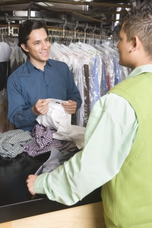 Man serving customer in the laundrette Stock Photo - 20741938