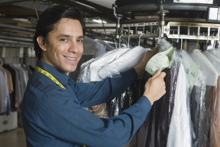Man working in the laundrette Stock Photo - 20741941